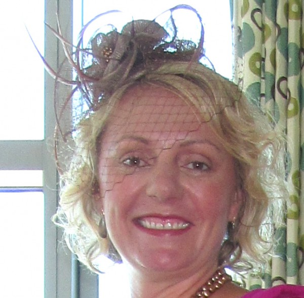 Kathi Burns wardrobes a fascinator in time for Hat Day